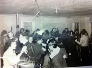 This is a dance in a Koyukuk River village at winter carnival time --Huslia or Huges, I don't know which. About 1955. That's me in the plaid jacket dancing with Frankie Simon.